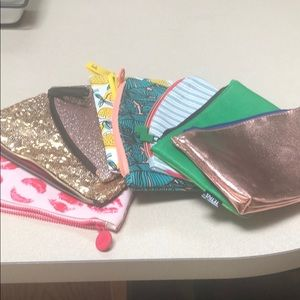 Eight Ipsy makeup bags. Never used.